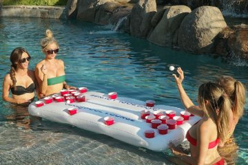 This Floating Beer Pong Table Is The Summer Pool Party Accessory You Need