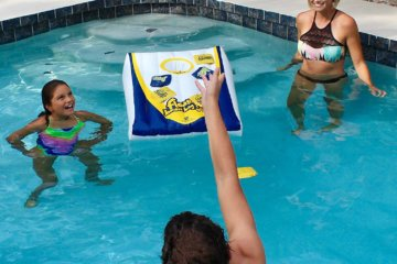 This Floating Cornhole Set Is Your Pool's New BFF