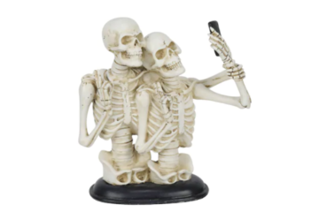 This Statue Of Skeletons Taking A Selfie Is Halloween Decor Done Right