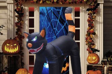 This 6 Foot Tall Inflatable Halloween Cat Has Flashing Eyes & A Moving Head