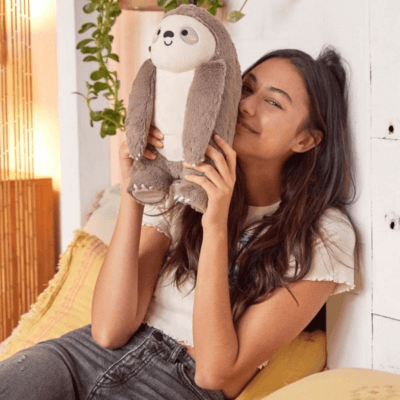 Urban Outfitters Is Selling A Heatable Sloth Plushie & We Need It Now