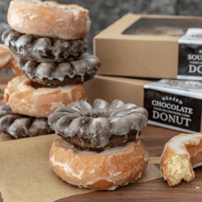 Trader Joe's Is Selling Glazed Chocolate And Sour Cream Donuts Now, Thank Goodness