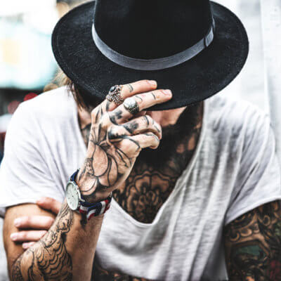 12 Things His Tattoos Say About Him
