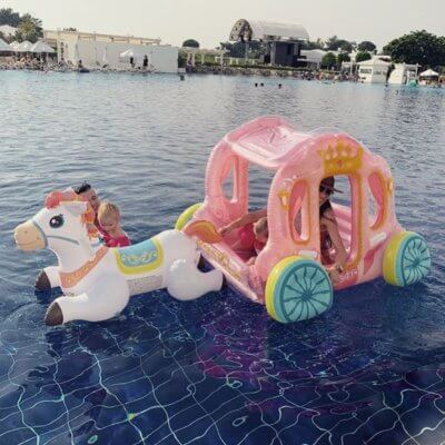 This Inflatable Horse And Carriage Pool Float Will Make You Feel Like A Queen