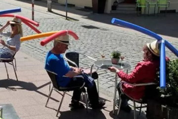 Reopened German Cafe Gives Customers Pool Noodle Hats To Enforce Social Distancing