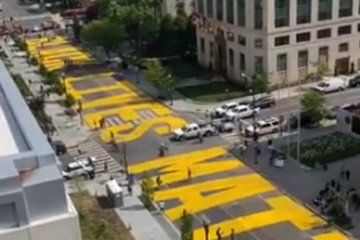 Activists Paint Huge 'Black Lives Matter' Sign On Road To White House