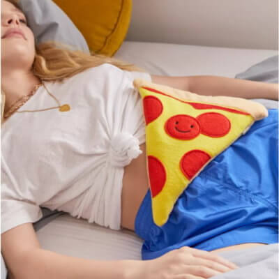 This Smiling Pepperoni Pizza Heating Pad Will Make Cramps A Lot Less Painful