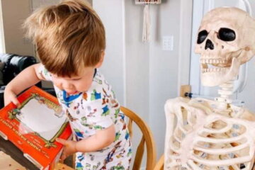 This Little Boy Is Best Friends With A 5-Foot Skeleton And It's Super Cute