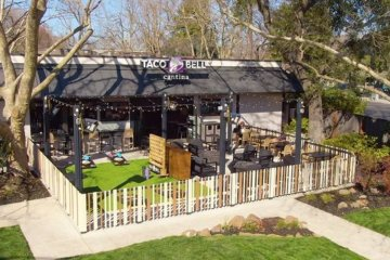 Taco Bell Has Opened A New Restaurant With An Outdoor Fire Pit And Games Area