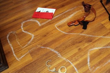Woman Shocked To Find Chalk Outline Of 'Body' With Case Number Under Her Living Room Carpet
