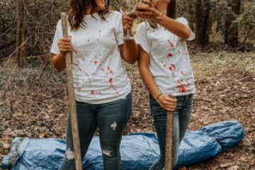 Best Friends Stage Horror-Themed Photoshoot Complete With Wine And A Dead Body