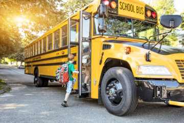 Heartwarming Photo Shows Bus Driver Holding Upset Boy's Hand On First Day Of School